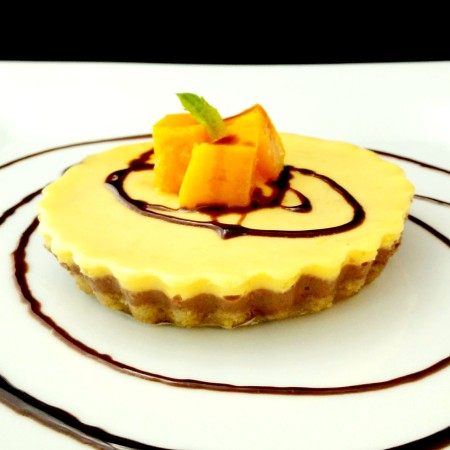 Baked Yogurt Cheesecake with Mango and Dark Chocolate